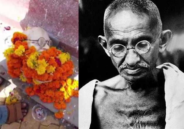 shocking head of mahatma gandhi s statue falls off during
