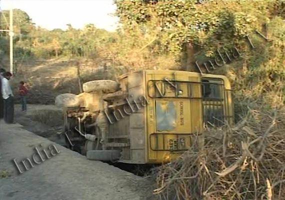 indore school bus with 60 children falls into drain