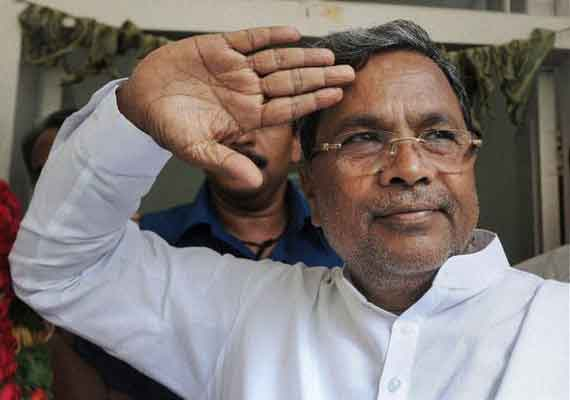 karnataka chief minister promises to solve farmers problems