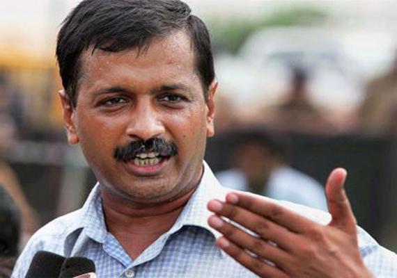 kejriwal attacks akhilesh for taking tainted ministers