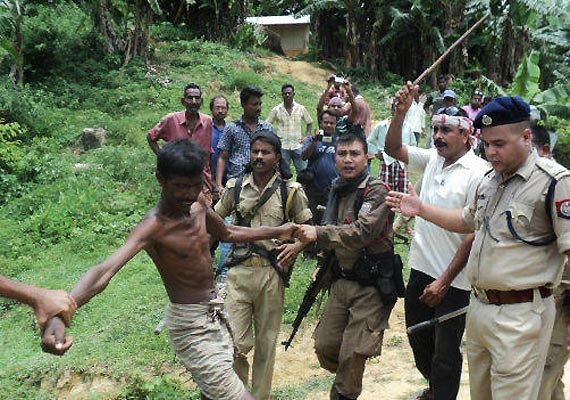 police fire in air to control mob in assam