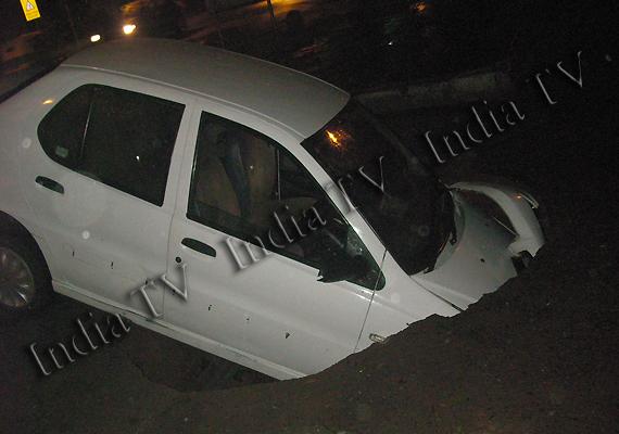 tata indigo car plunges as delhi road caves in