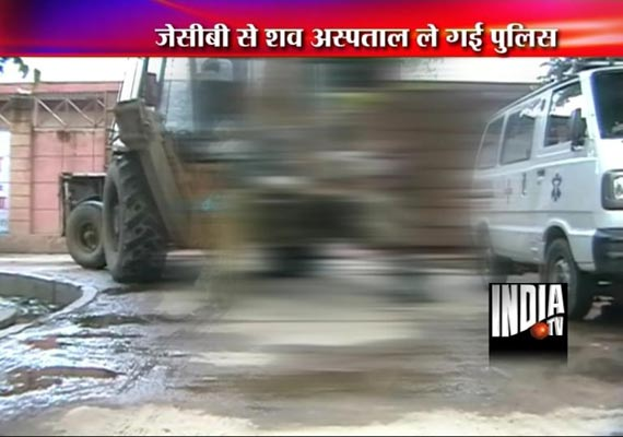 up police takes body of a man hanging from a jcb machine