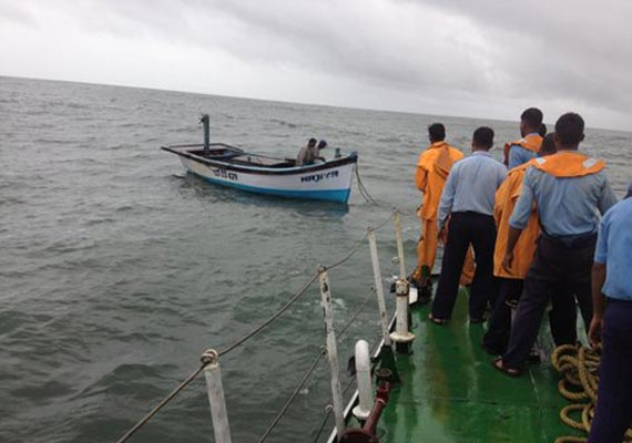 watch how coast guard rescued two indian crew of fishing