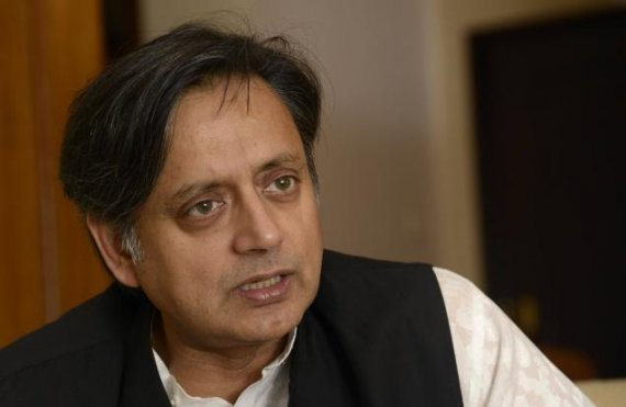 tharoor plunges into sanitation drive invokes gandhi to