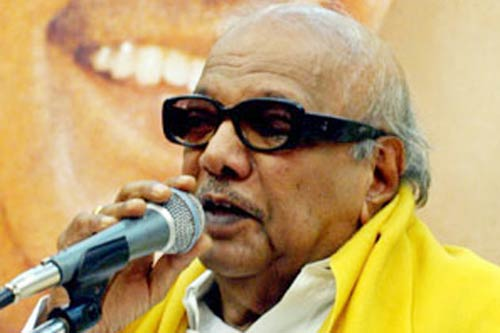 karunanidhi backs raja rules out resignation