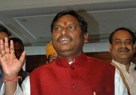 arjun munda demands resignation of jharkhand cabinet