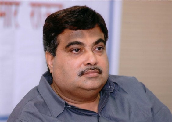 gadkari courts controversy by riding scooter without helmet