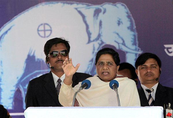 mayawati asks voters to give befitting reply for covering