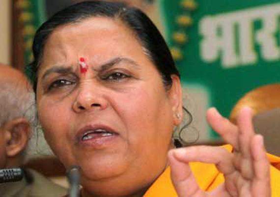 uma bharti takes potshots at gandhi family
