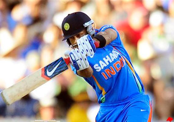 smashing kohli keeps india in the hunt for final berth