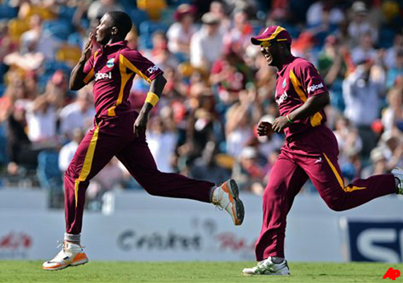windies beat australia by 14 runs in 2nd t20