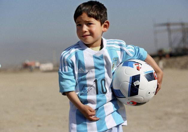 messi replaces five year old afghan boy s plastic bag