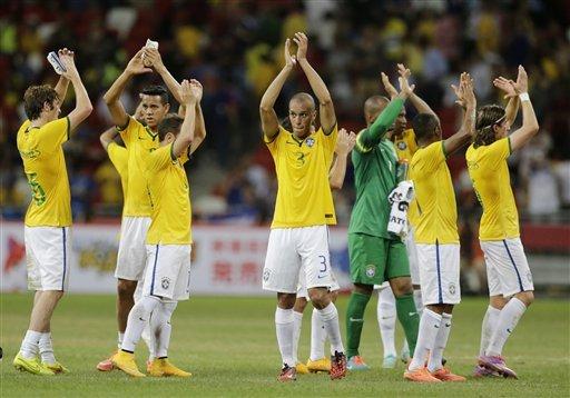 brazil players told not to wear hats earrings