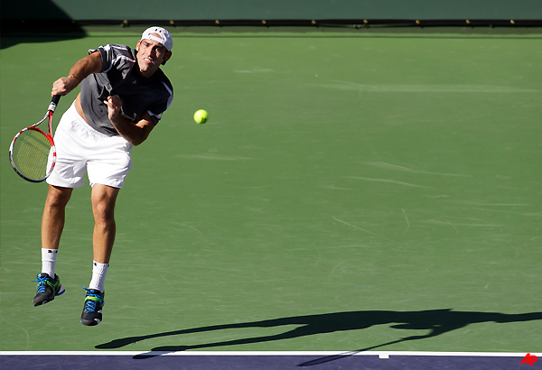 ginepri bounces back from losing first set to win
