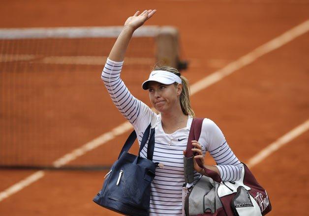 sharapova s return suffers setback at wuhan open
