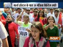 ABVP holds protest march against illegal land occupation near DU