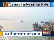 Devotees take a holy dip in River Ganga on the occasion of Kartik Purnima