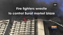 Fire fighters wrestle to control Surat market blaze