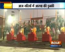 Devotees offer prayers and take holy dip in river Ganga on occasion of Makar Sankranti