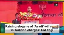 Raising slogans of