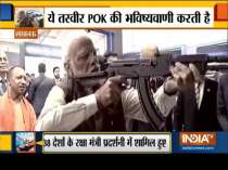 WATCH: At Defence Expo, PM Modi fires at virtual firing range with assault rifle