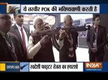 Defence Expo 2020: PM Modi tests his shooting skills with an assault rifle