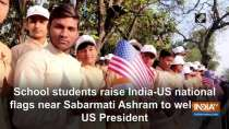 School students raise India-US national flags near Sabarmati Ashram to welcome US President