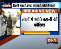 Delhi violence: Security forces conduct flag march in Maujpur