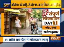 Coronavirus: People maintain distance while standing in queue to buy medicines in Mumbai
