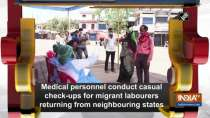 Medical personnel conduct casual check-ups for migrant labourers returning from neighbouring states