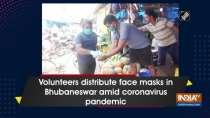 Volunteers distribute face masks in Bhubaneswar amid coronavirus pandemic