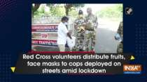 Red Cross volunteers distribute fruits, face masks to cops deployed on streets amid lockdown