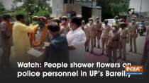 Watch: People shower flowers on police personnel in UP