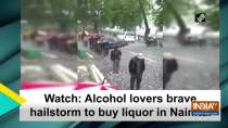 Watch: Alcohol lovers brave hailstorm to buy liquor in Nainital