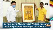 Dr Ram Dayal Munda Tribal Welfare Research Institute presents painting to Jharkhand CM