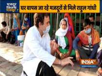 Congress leader Rahul Gandhi interacts with migrant labourers who were returning to their home states