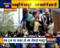 Hundreds of laborers boarded a truck to go home in Vidisha, Madhya Pradesh
