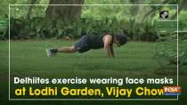 Delhiites exercise wearing face masks at Lodhi Garden, Vijay Chowk