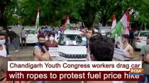 Chandigarh Youth Congress workers drag car with ropes to protest fuel price hike