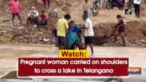 Watch: Pregnant woman carried on shoulders to cross a lake in Telangana