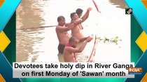 Devotees take holy dip in River Ganga on first Monday of