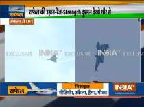 Air display of Rafale aircraft flanked by SU-30 and Jaguar aircraft in arrow formation