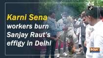 Karni Sena workers burn Sanjay Raut