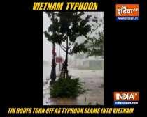 Tin roofs torn off as typhoon slams into Vietnam