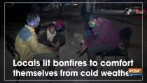 Locals lit bonfires to comfort themselves from cold weather