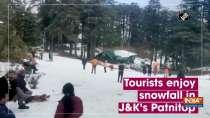 Tourists enjoy snowfall in J&K