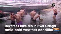 Devotees take dip in river Ganga amid cold weather conditions