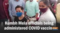 Kumbh Mela officials being administered COVID vaccine