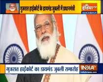 PM Modi unveils postage stamp on Gujarat High Court